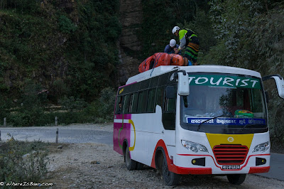 our daily commute tieing kayaks ontop of a bus in nepal himalayas Upper Marsyangdi river whitewater, Nepal, WhereIsBaer.com Chris Baer