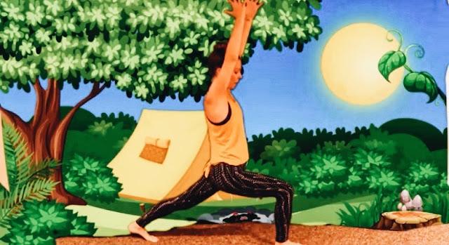 Laura Kowalski of Hop Along Yogi teaching an online kids' yoga class.