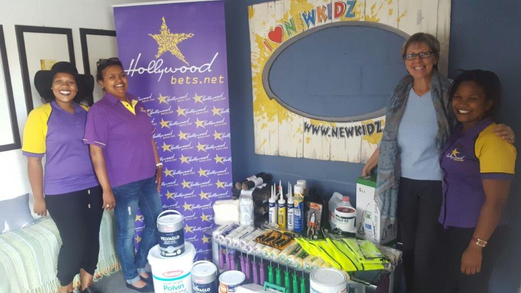 Newkidz on the Block staff members are thankful for a donation of hardware supplies from Hollywoodbets