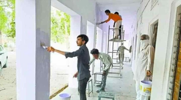 labourers painting school