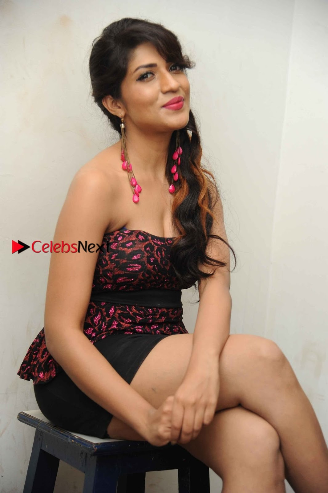 Iti Acharya Stills in Strapless Dress at Dhwani Movie Press Meet