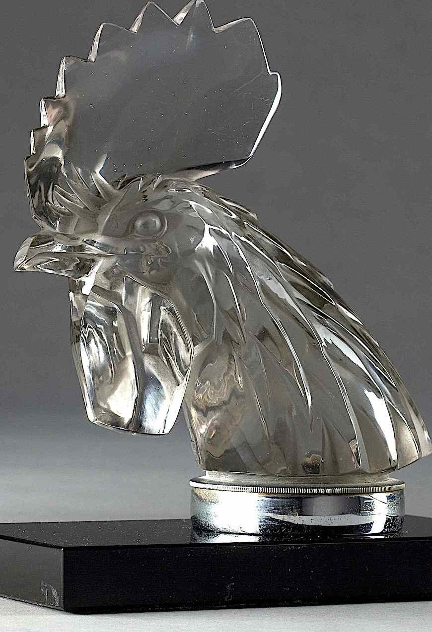 a Lalique glass car hood ornament, a rooster mascot, color photograph