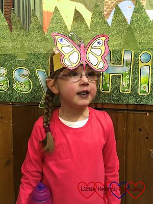 Jessica wearing a butterfly headband