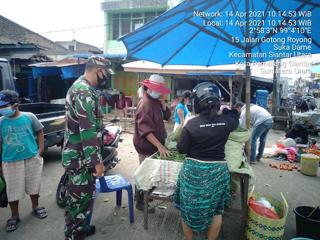 Tepatnya Dipasar Dwikora Parluasan, Personel Jajaran Kodim 0207/Simalungun Laksanakan Penegakan Protokol Kesehatan