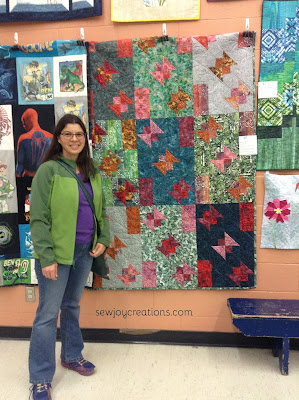 quilter with butterfly quilt