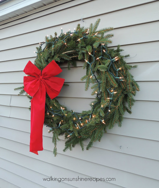 Christmas Wreath hung and lit made by the Colonel for Walking on Sunshine.
