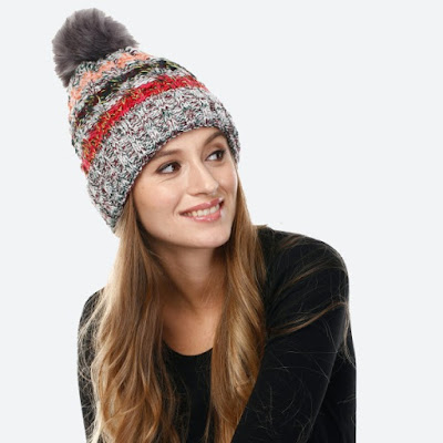 grey thick and cozy winter hat with pink, green, and red stripes and a big pompom