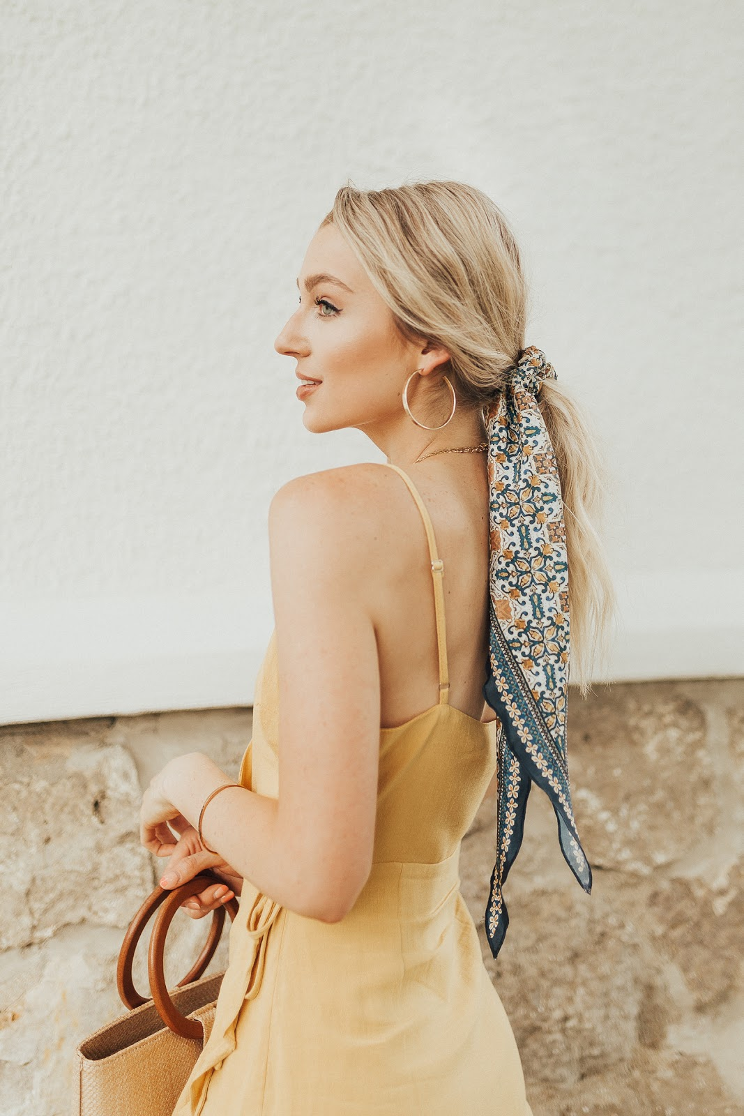 dress up a ponytail with a hair scarf