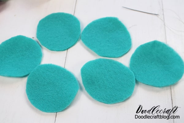 Felt Flower #1: Step 1: Cut Felt Begin by cutting out 5-6 circles of felt. I just eyeballed the shape, they don't need to be too precise.