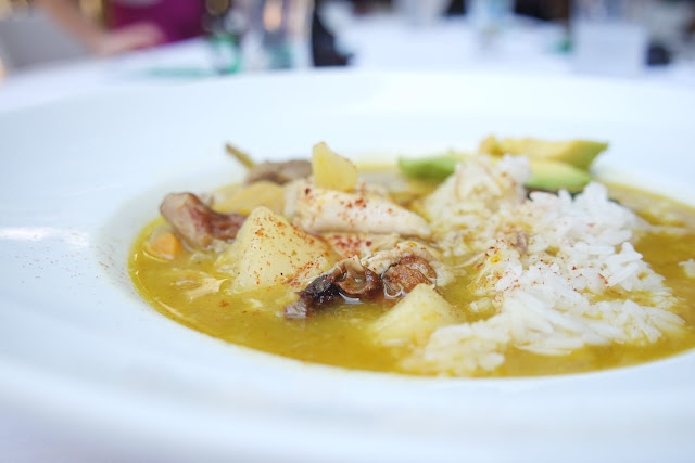 Sancocho with long grain rice and fresh avocado.