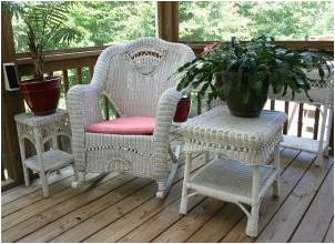 a wicker chair and two wicker tables