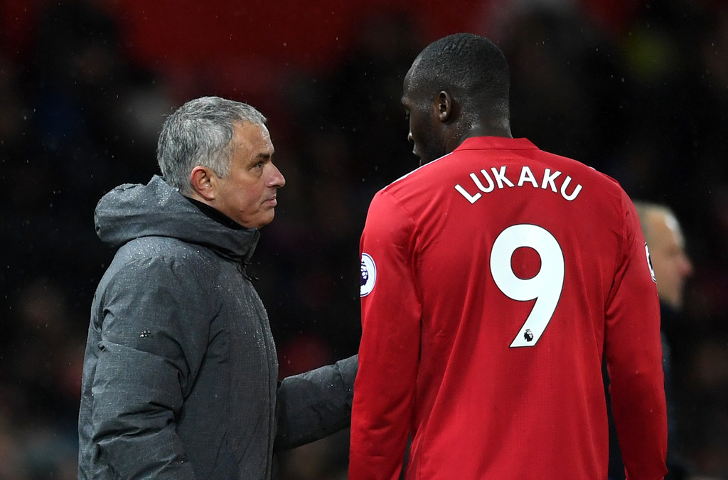 Jose Mourinho, Manager of Manchester United speaks with Romelu Lukaku during the Premier League match between Manchester United and Brighton and Hove Albion at Old Trafford on November 25, 2017 in Manchester, England