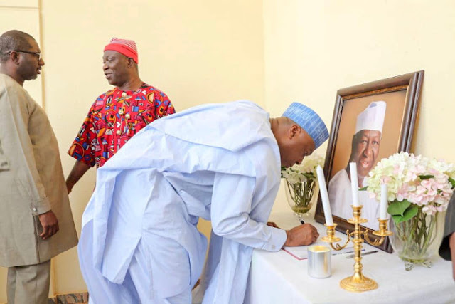 Saraki signing the condolence register at the residence of late Chief Tony Anenih
