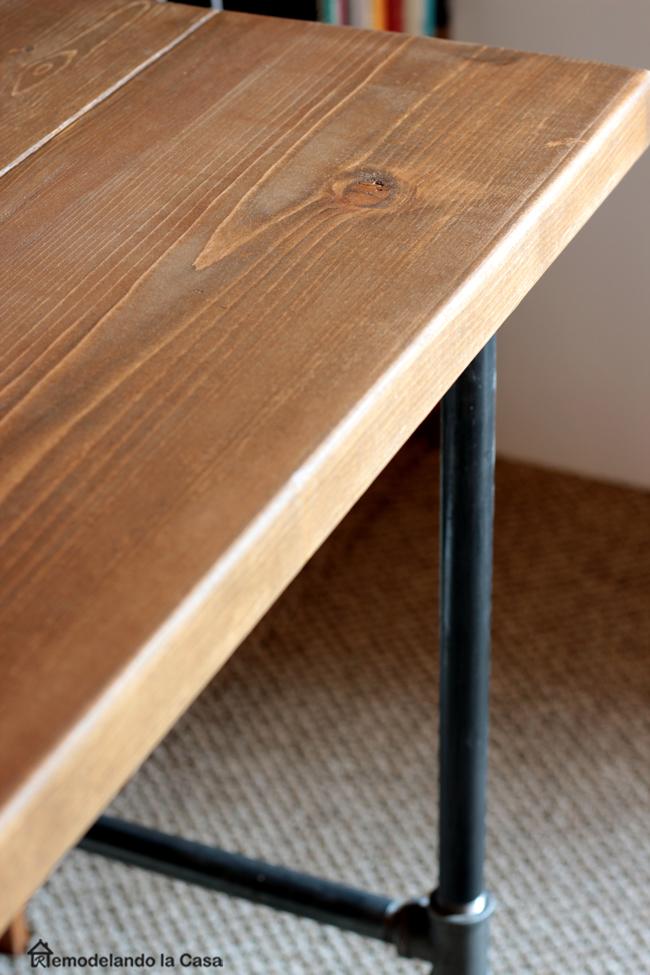 wooden desktop and metal pipe base desk.