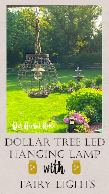 wire hanging lantern green grass yard fountain