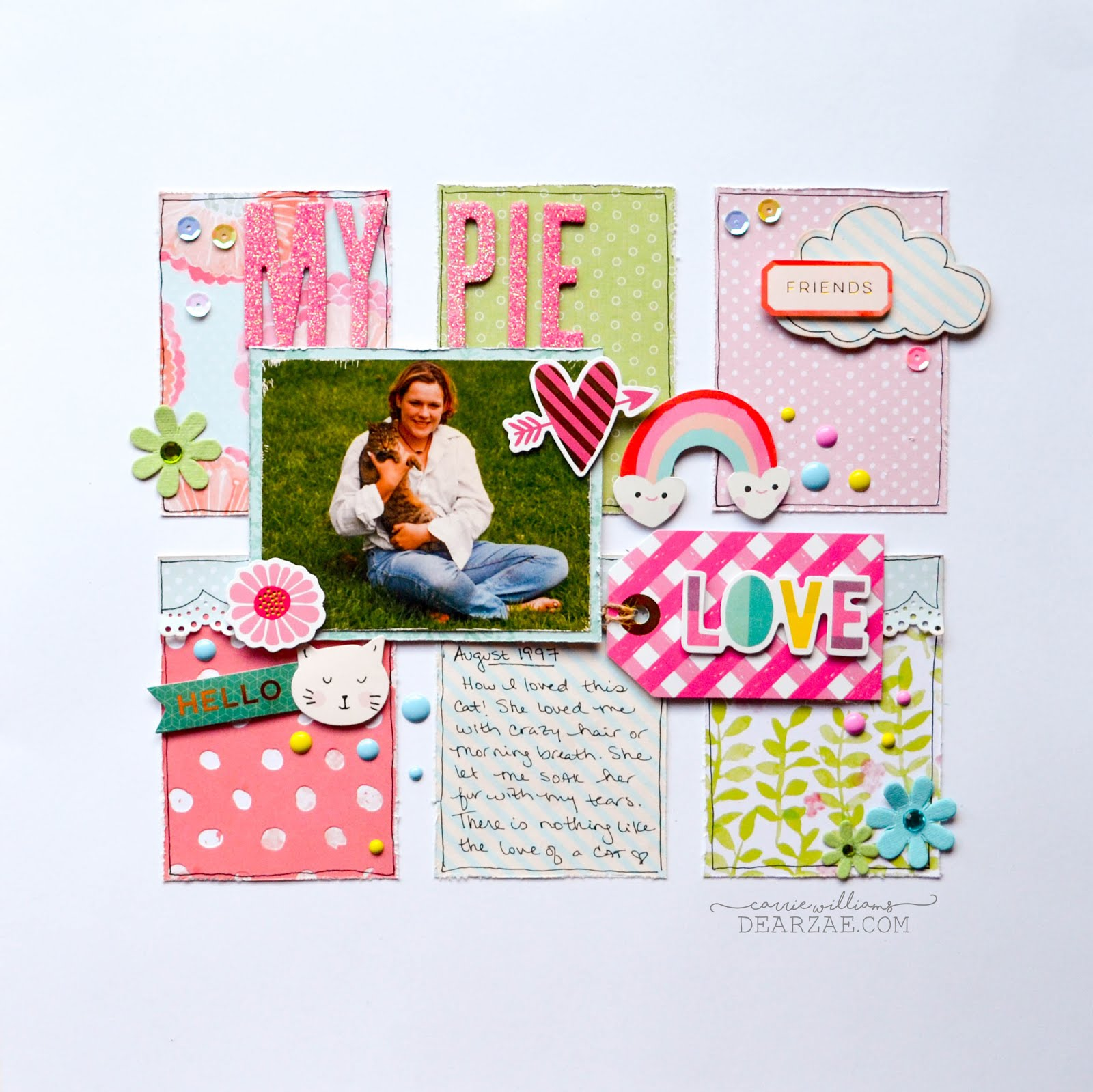 Pastel cat scrapbook page layout in pinks, blues, and greens. with thickers, sequins, die cuts