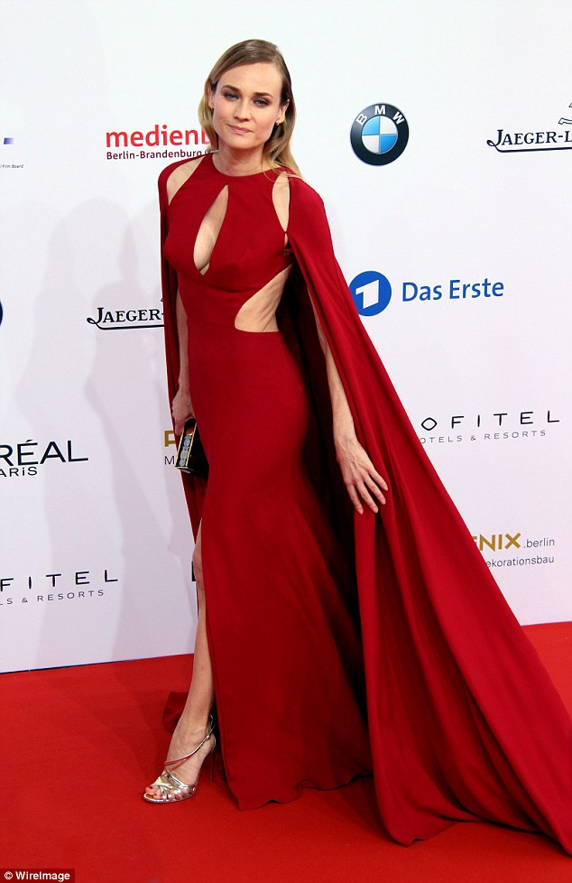 Diane Kruger epitomises fairy tale glamour as she channels Little Red Riding Hood in a scarlet caped gown with sexy cut-outs at German Film Awards