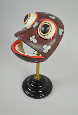 Purple frog mask on stand