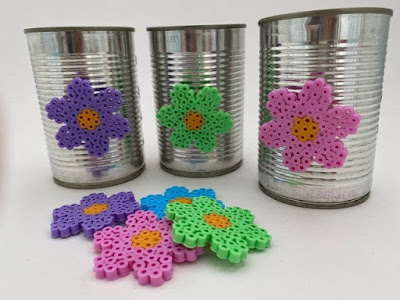 Upcycled tin cans decorated with Hama bead flowers