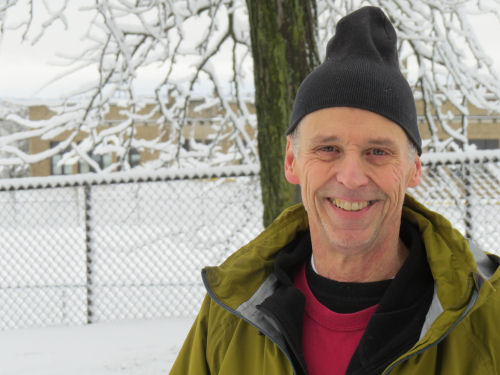 smiling man in winter clothes