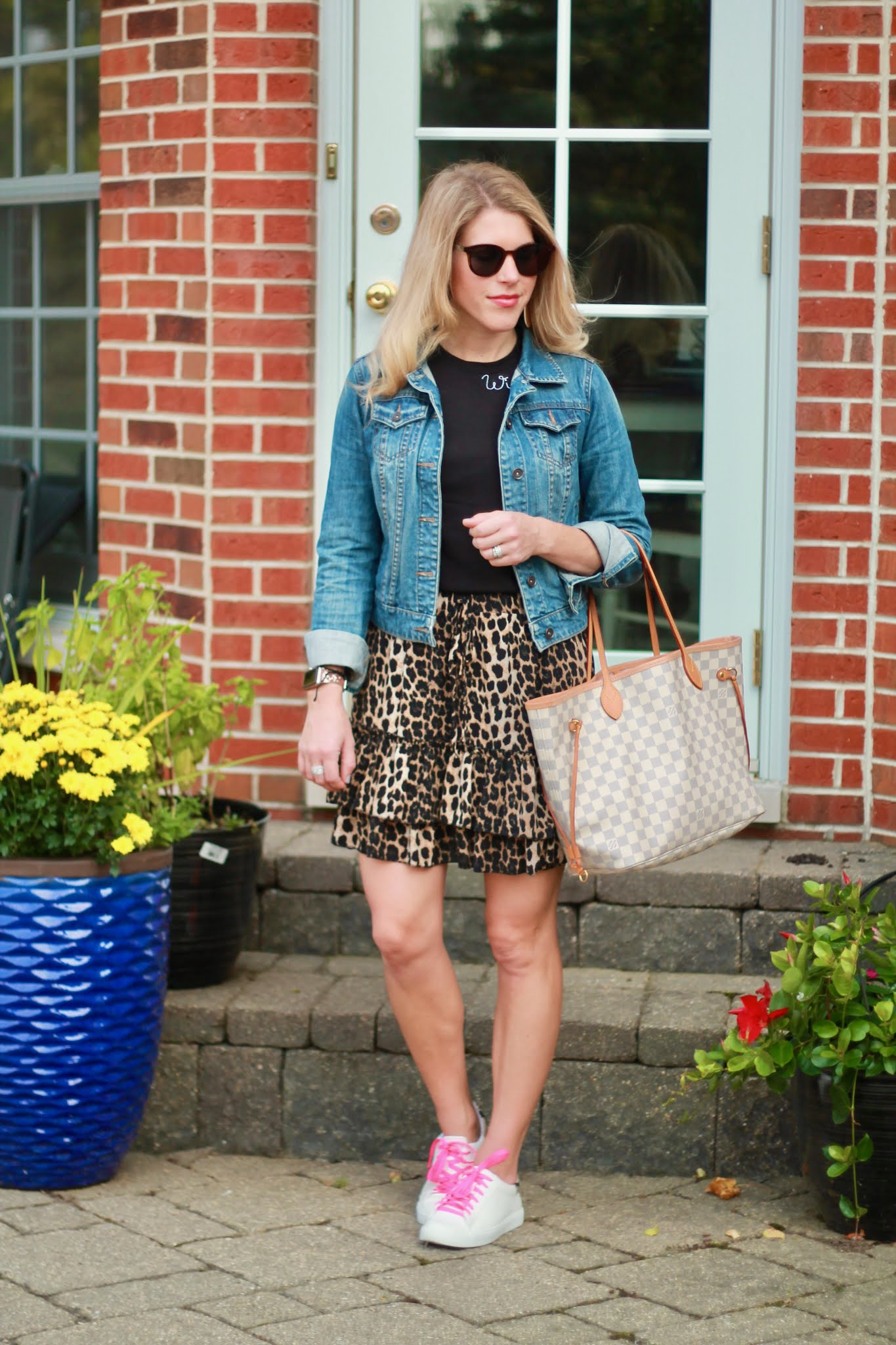 casual skirt outfit for fall, leopard skirt for fall, fall outfit with skirt, skirt and sneakers, leopard skirt, denim jacket, wine please tee