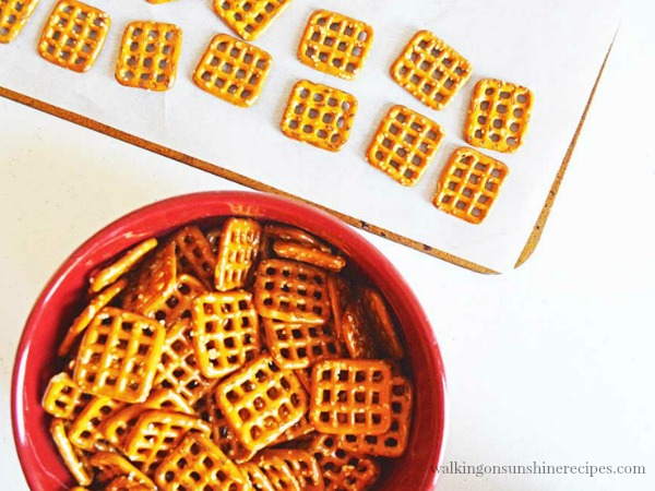 Lay square pretzels on baking tray  for Hugs Pretzel Treats from Walking on Sunshine Recipes