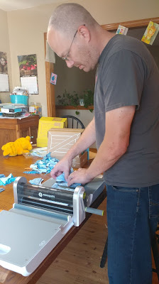 My husband using an AccuQuilt GO! cutter