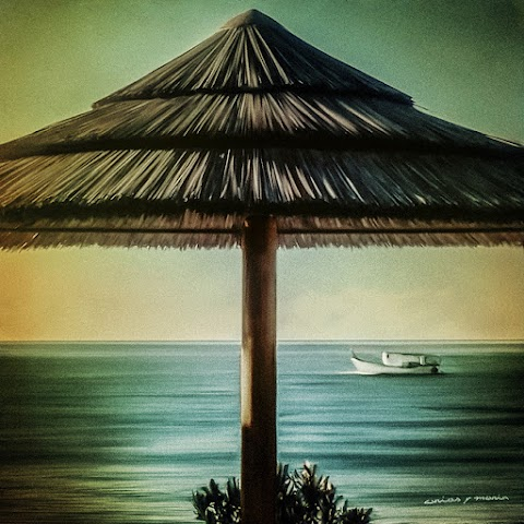 Sombrilla y barco