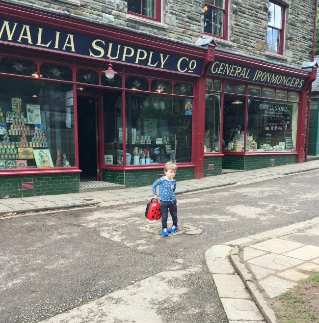 toddler-holding-My-Carry-Potty-from-Cheeky-Rascals-at-st-Fagans-museum-gwalia-stores