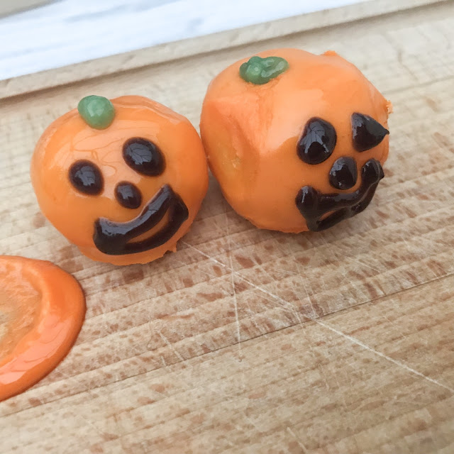Pumpkin bites with faces iced on
