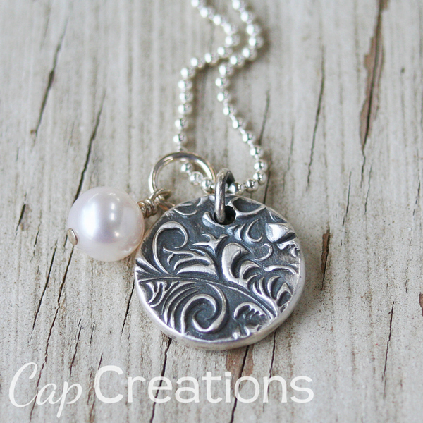 http://www.capscreations.com/item_999114/Wax-Seal-Pendant.htm