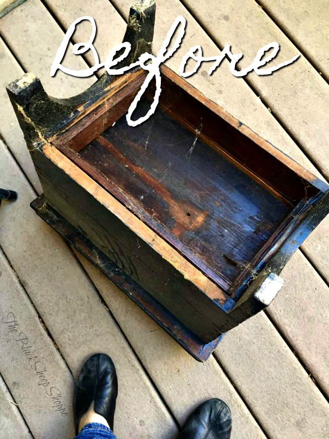 The bottom reveals the original wood finish of the shoe shine box. At some point it was painted black.