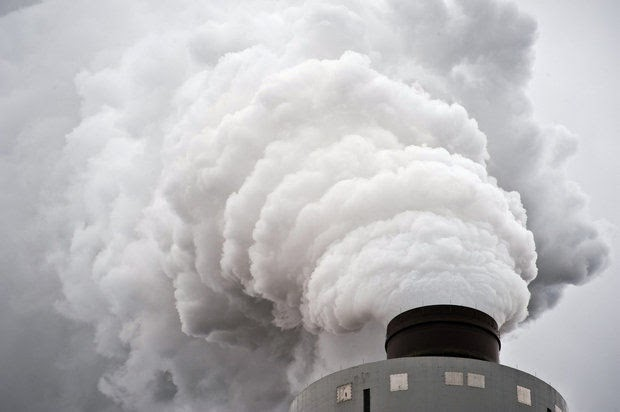 Steam rises from the stack of a scrubber as the primary emission after the cleaning process at a coal-fired power plant outside Baltimore, Maryland, in this 2011 photo. (Credit: Andre Chung/MCT) Click to enlarge.