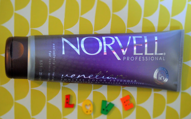 A purple tube of Norvell on a green and white background.