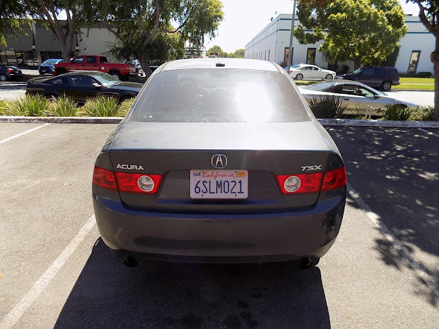 Dull, faded paint on Acura TSX before overall paint job at Almost Everything Auto Body.