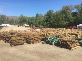 Hundreds of readied sandbags on pallets waiting to be deployed in Tonasket.