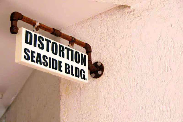 Distortion Seaside Building Sign