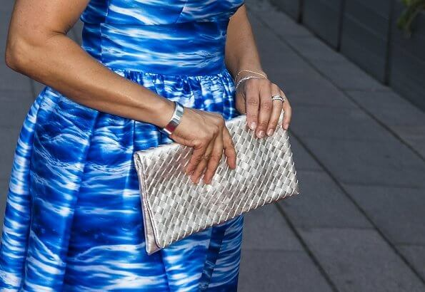 Crown Princess Victoria wore a Camilla Thulin sea blue print dress and Anya Hindmarch metallic clutch