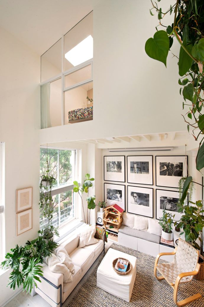 Loft view that showcases plants and gallery wall