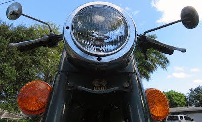 Photo from front of motorcycle with left and right mirrors visible.