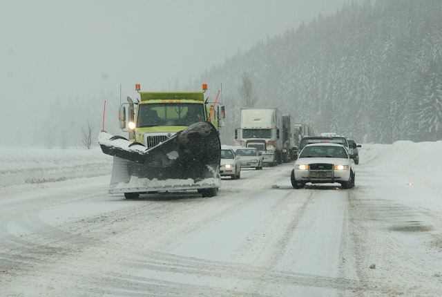 Photo of snow plow and traffic on I-90 Snoqualmie Pass