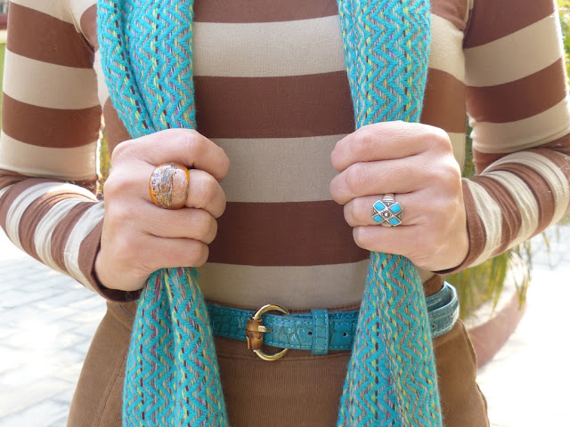 Corduroy skirt with turquoise belt, turquoise scarf, turquoise ring and stripy top
