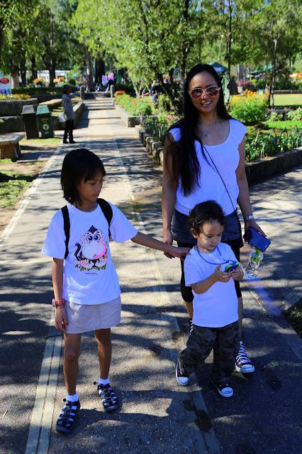 Walking with two kids at Burnham Park