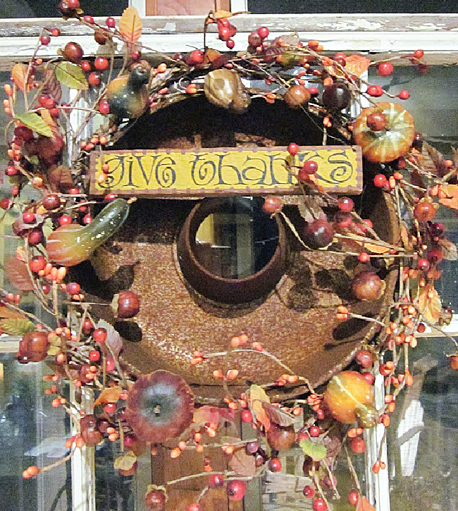 rusty thanksgiving wreath with give thanks sign