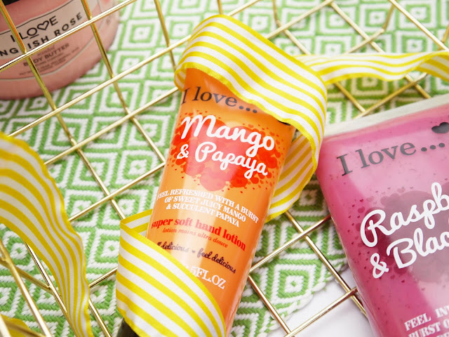 an orange tube of I Love Mango and Papaya hand cream wrapped in a yellow ribbon