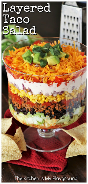 Layered Taco Salad {For a Crowd or Family Taco Night!} ~ Whip up this Layered Taco Salad instead of stuffing those taco shells! Perfect for lower-fuss taco night prep, or for making salad for a crowd. #tacosalad #layeredsalad #taconight #TacoTuesday  www.thekitchenismyplayground.com
