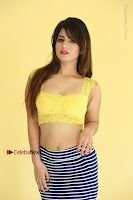 Cute Telugu Actress Shunaya Solanki High Definition Spicy Pos in Yellow Top and Skirt  0111.JPG