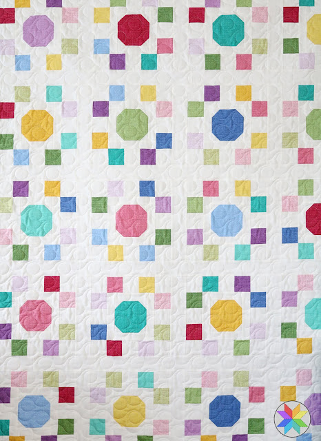 """Spot On quilt pattern - a pattern in four sizes perfect for using precut 10"""" squares.  Pattern by Andy of A Bright Corner"""