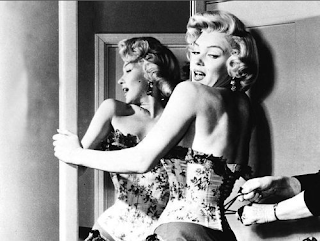 Marilyn Monroe tighten corset laced holding mirror