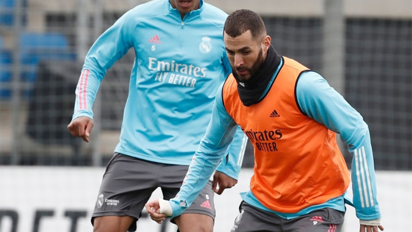 karim-benzema-with-rapha%C3%ABl-varane-of-real-madrid-cf-a-news-photo